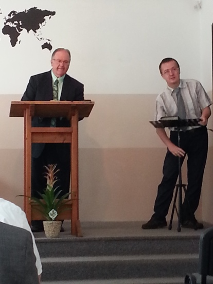 Bro. Graham preaching with Bro. Louis interpreting.